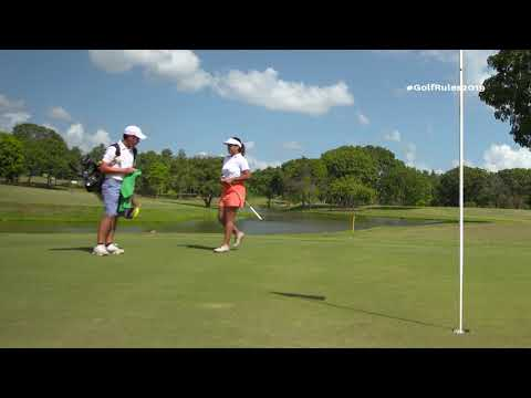 Golf's New Rules (2019): Caddie Lifting Ball on Putting Green