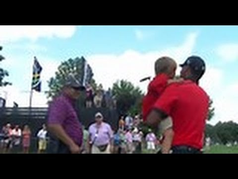 Tiger Woods wins and hugs his son Charlie