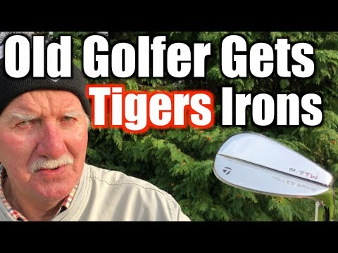 Amazing old golfer gets his hands on TIGER WOODS IRONS  !   WOW